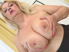 Big breasted mature lady playing with her pussy