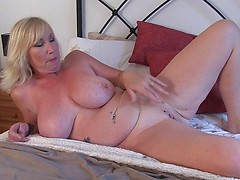 British big breasted lady Melody Charm fingering herself
